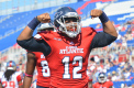 Quarterback Jaquez Johnson celebrates after scoring his second touchdown in FAU's 45-38 win over WKU last season. With a new number and less weight on him, Quez and his teammates will fight for a conference championship. Photo by Michelle Friswell