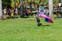 Jaelyn Benson running in the housing lawn with a flag during Pride Fest [Mohammed F Emran | Web Editor]