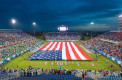 A 100-yard long American flag is held out during the singing of the National Anthem prior to the first-ever kick off of the Boca Raton Bowl. Max Jackson | Photo Editor