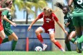 Captain and senior midfielder Claire Emslie dodges a defender during the Owls' matchup versus Stetson in 2014. Emslie netted a goal and had an assist in the team's 4-1 win against Stetson in this year's matchup. Photo by Ryan Murphy.