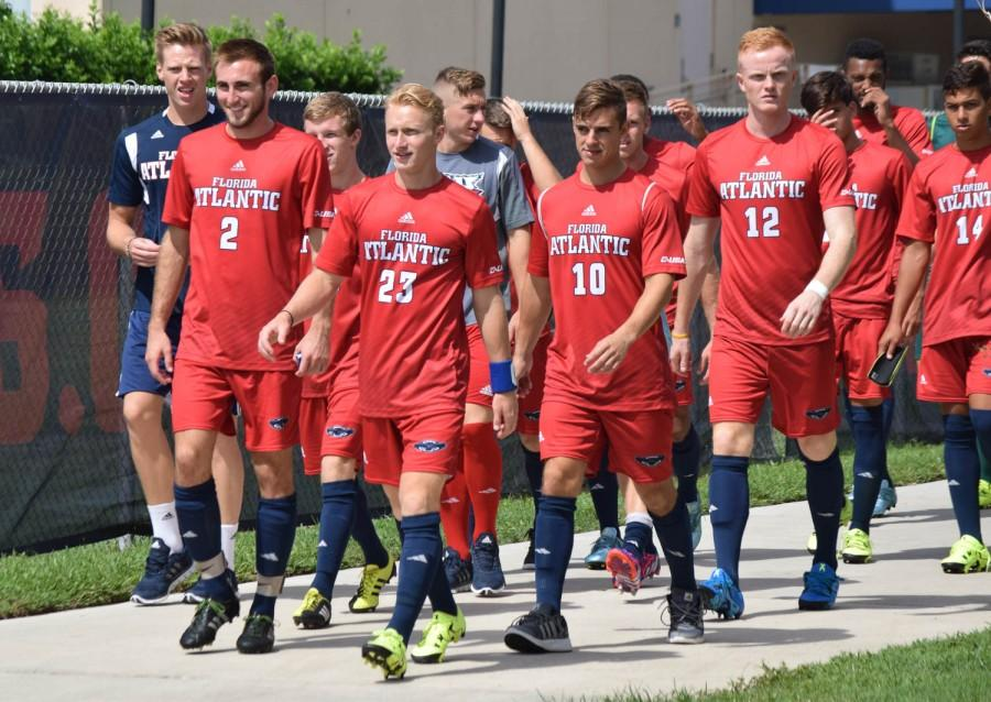 FAU+men%E2%80%99s+soccer+comes+out+of+the+Oxley+Center+after+an+hour+and+a+half+lighting+delay+before+their+game+versus+Fairfield+University+on+Sept.+6.+Ryan+Lynch+%7C++Sports+Editor