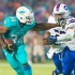 Miami Dolphins running back Damien Williams stiff arms linebacker Preston Brown during Miami's 22-9 win versus the Buffalo Bills last year. The Dolphins play the New York Jets in London on Sunday morning. Max Jackson|Photo Editor