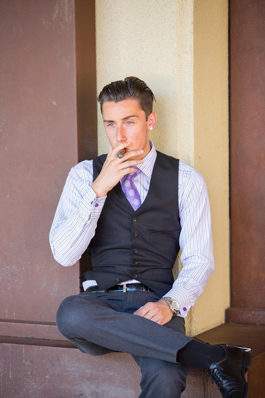 Collon Paul-Hus, freshman, undeclared major, smoking a cigar. Brandon Harrington | Photo ditor