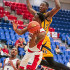 Redshirt junior guard Adonis Filer goes for a layup while Warner's defender jumps to block during the Owls' 75-72 loss on Nov. 17. Mohammed Emran   Asst. Creative Director