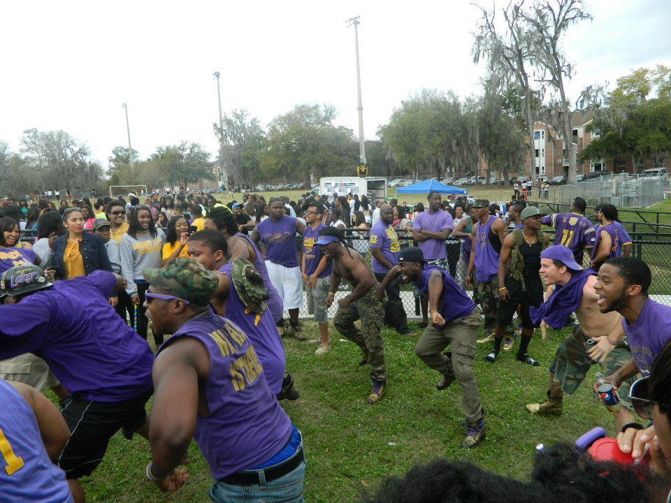 Many of FAU's Omega Psi Phi chapter members wear purple and gold tops with camouflage bottoms at an event. This photo comes from an untitled album from 2012. Photo via Omega Psi Phi Fraternity Inc. - Sigma Delta Delta Chapter (FAU)'s Facebook page.