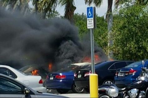 Car catches fire in parking lot 7