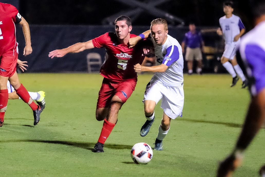 Sophomore midfielder Christian Williams battles for possession in the Owls game against Niagara. Mohammed F. Emran | Staff Photographer
