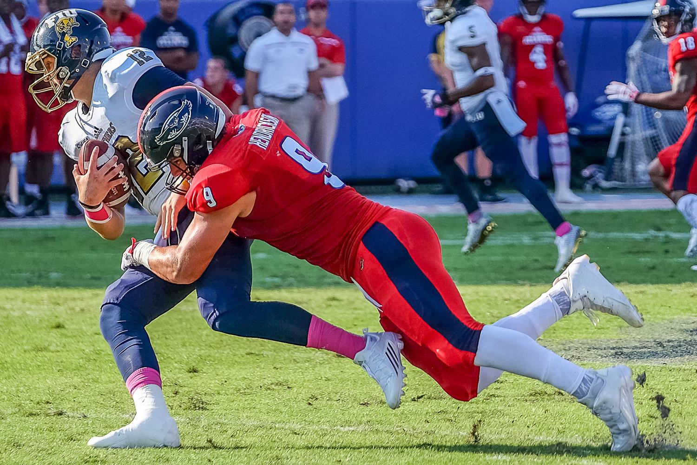 Trey Hendrickson (9) tackles Florida international quarterback Alex McGough for one of his 13.5 sacks during the 2015 season. Mohammed F Emran