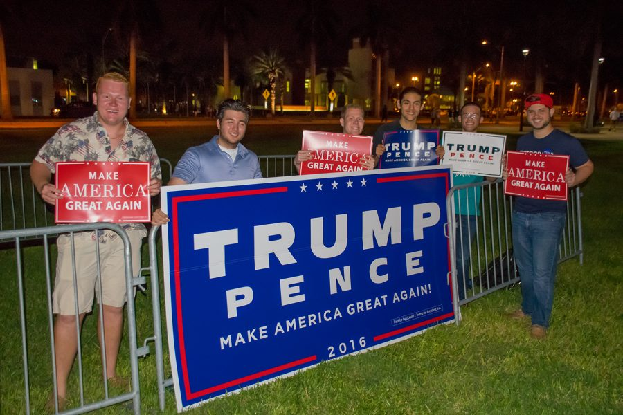The+FAU+College+Republicans+display+signs+supporting+Donald+Trump+before+the+start+of+the+third+presidential+debate.+Craig+Ries+%7C+Contributing+Photographer
