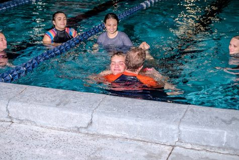 On-campus swimming program gives students the chance to work with kids with disabilities