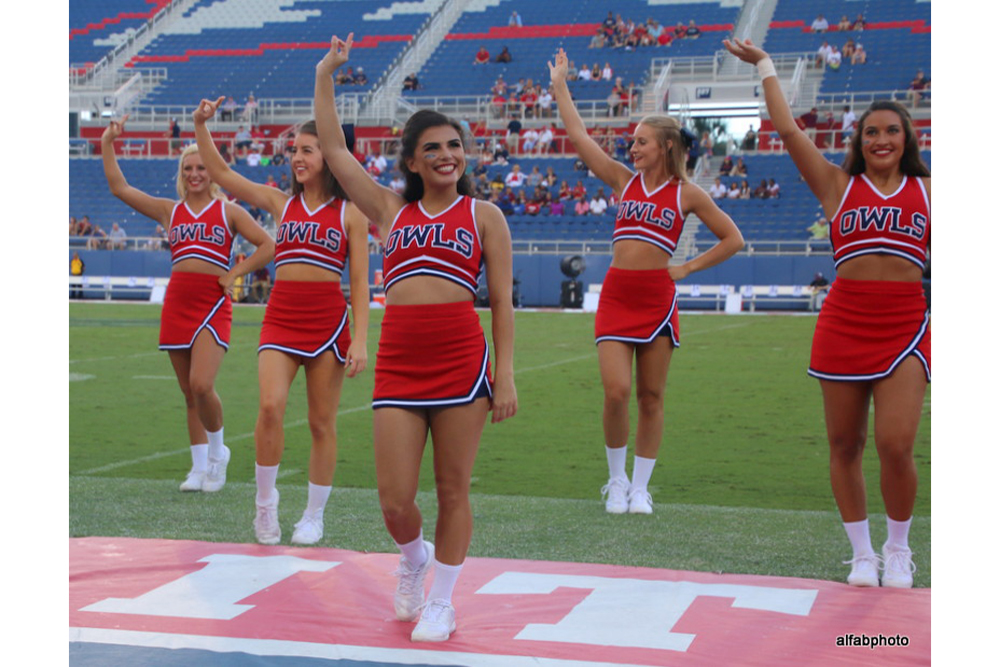 (From left to right) Sophomore Gabbe Moore, freshman Sydney Hafen, freshman Karina Cruz and sophomore Sierra Teska wave to the crowd during a football game.  Photo courtesy of FAU Athletics