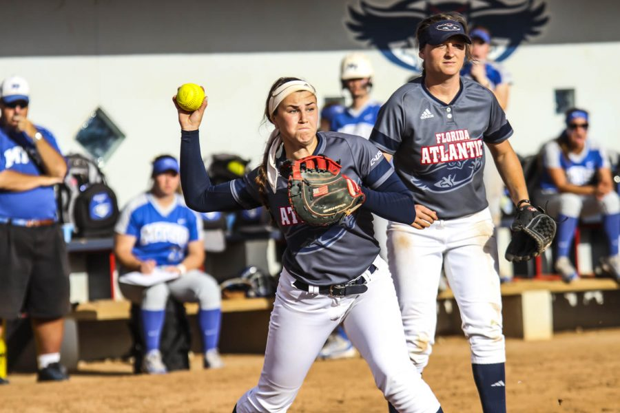 Sophomore+Lauren+Whitt+%2819%29+throws+the+ball+toward+first+base+a+Middle+Tennessee+player+hit+a+ground+ball+to+her+during+her+team%27s+game+on+April+14.+Alexander+Rodriguez+%7C+Contributing+Photographer