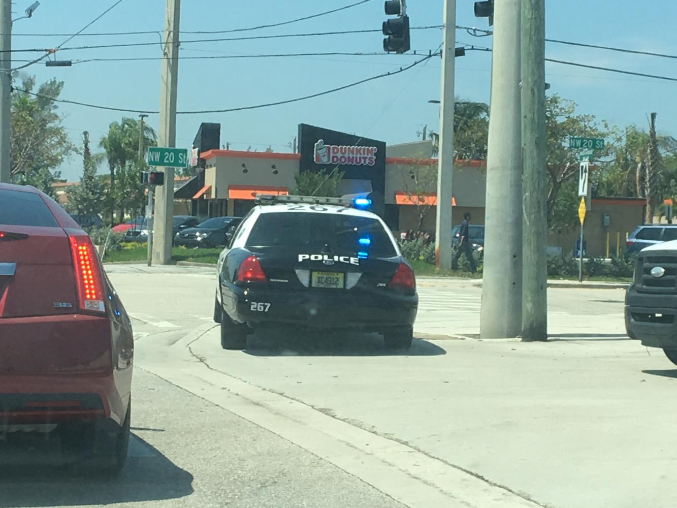 A Boca Raton police cruiser sits at the intersection of 20th and 2nd Street Friday while the department looks for a suspect in the area. Joe Pye | News Editor