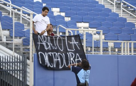 Venezuelan soccer fans have anti-dictatorship signs removed by FAU police