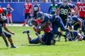 Junior-Adrian-Sterling's-helmet-is-knocked-off-after-he-was-tackled-by-Richard-Thompson-26.-He-gained-three-yards-on-the-play.-Mohammed-F-Emran-Web-Editor