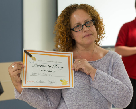 Winner of the Spelling Bee Professor Becka McKay poses with her award. Photo by Kiki Baxter.