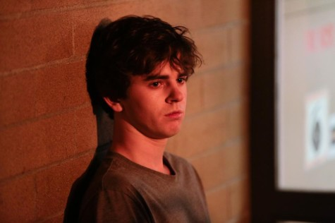 Norman (Freddie Highmore) waits to be questioned by police. Images courtesy of www.aetv.com.