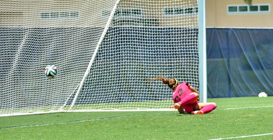 Stetson goalkeeper Ashley Ingolia unsuccessfully dives for Taylor Townsends shot. Townsend's goal brought FAU to 2-0 over the Hatters. [Ryan Murphy|Business Manager]