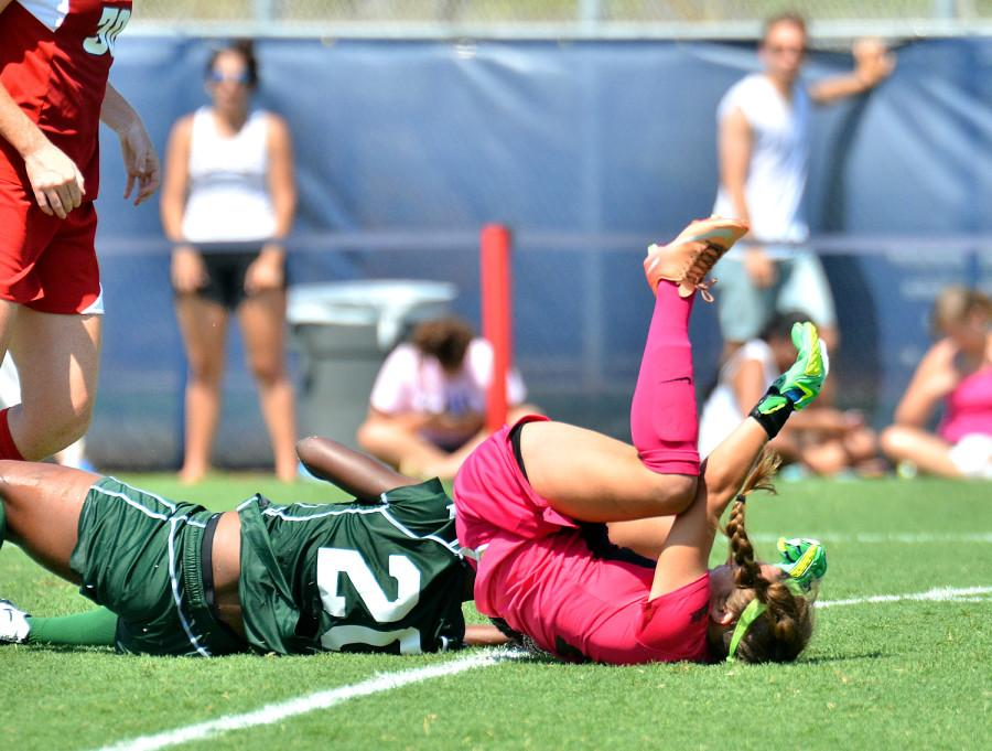Stetson players Makeshia Lucien and Ashley Ingolia hit the ground after a midair collision.[Ryan Murphy|Business Manager]