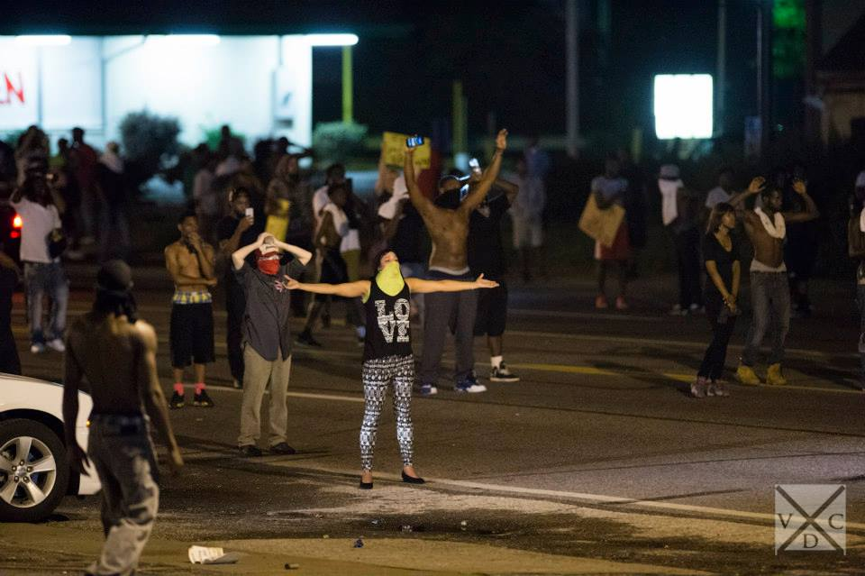 """The crowds yell out to the police """"Don't shoot, hands up"""" in Ferguson, Missouri. [Abe Van Dyke 