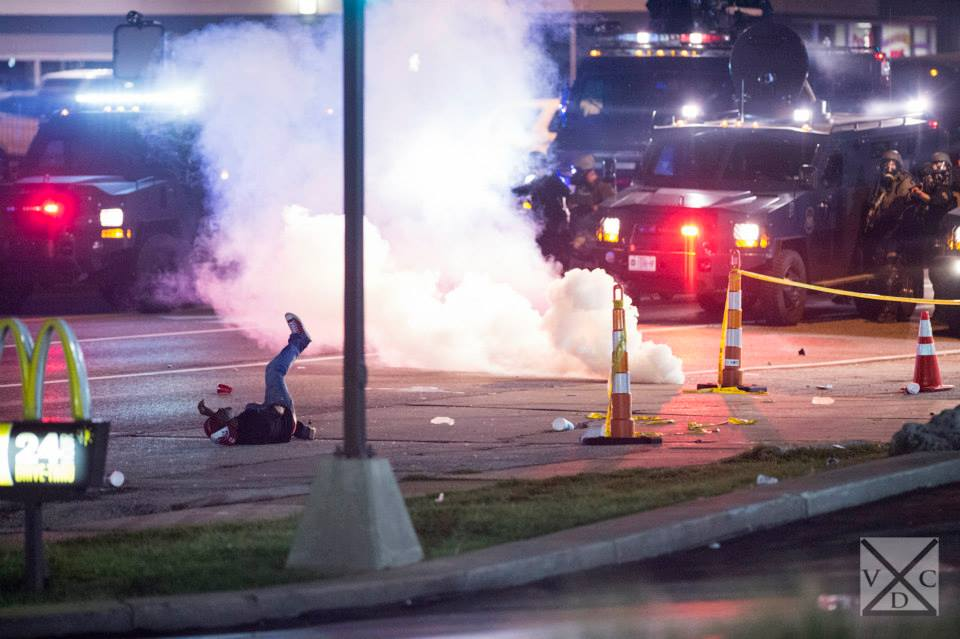 Police firing tear gas to disperse crowds in Ferguson, Missouri. Photo by VDC Photo 2014