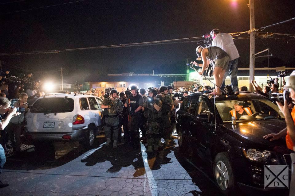 A big police presence amidst many media outlets in Ferguson, Missouri. [Abe Van Dyke | VDC Photo]