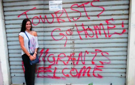 FAU student Holly Olsen stands in front of graffiti in San Zaccaria in Venice, Italy during her study abroad trip in summer 2014. Photo courtesy of Holly Olsen.