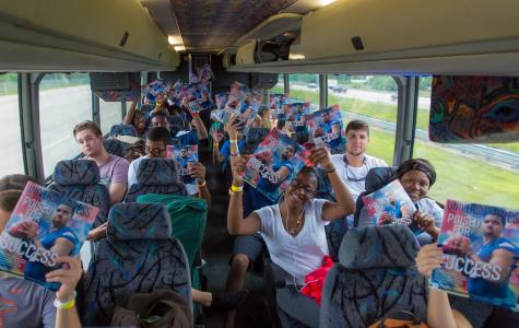 [Max Jackson | Photo Editor] FAU students took three buses leaving the Boca campus on the evening of Friday, Sept. 5.  Pictured are bus riders reading the University Press' Football Special Issue.