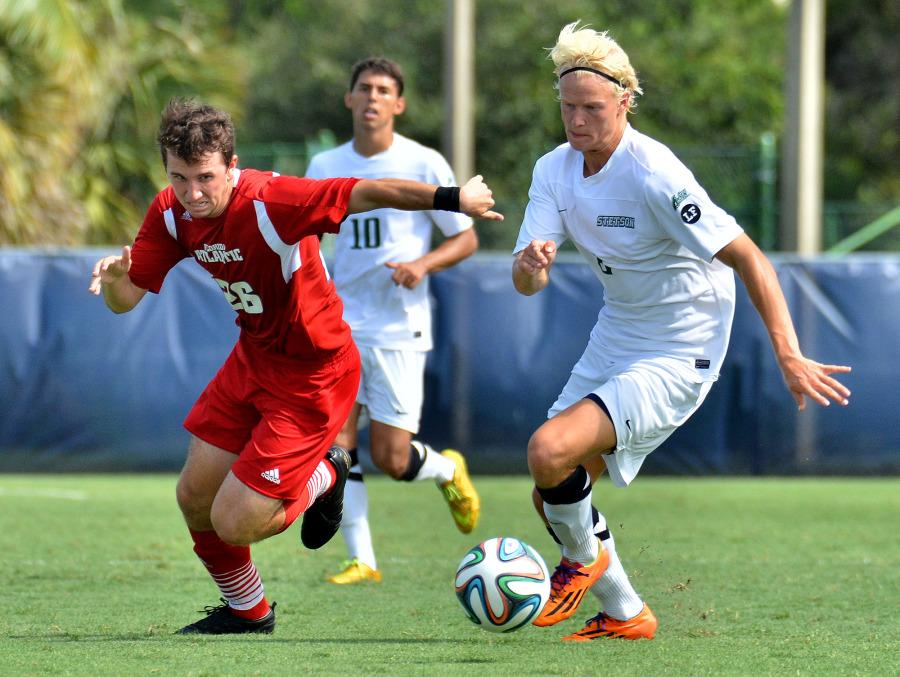 [Ryan Murphy | Business Manager] FAU forward Kevin Haller and Stetson's Jeppe Moe vie for the ball during the Owl's home opener.