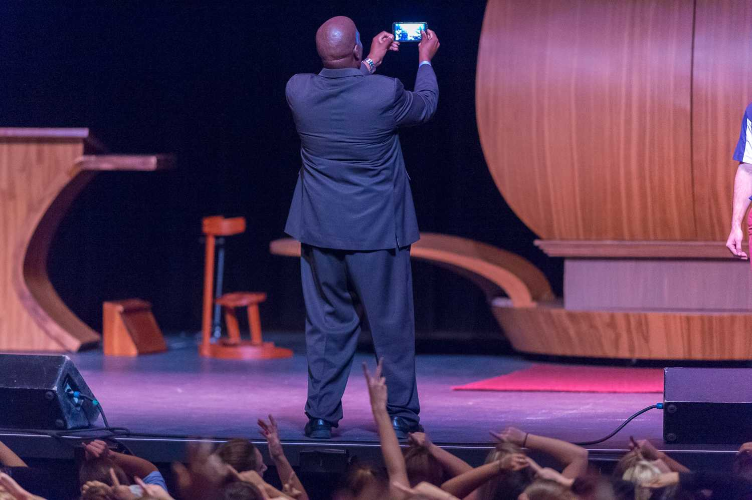 """Interim Vice President of Student Affairs Corey King took a selfie with the crowd before the Summit in hope of """"getting more hearts."""" Photo by Max Jackson 