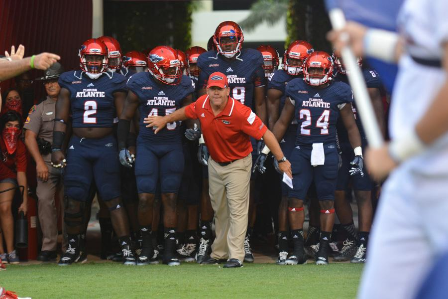 Head Coach Charlie Partridge holds the team back as they get set to play Tulsa for the Owls' home opener last year. This year's matchup will be played in Tulsa. Photo by Michelle Friswell