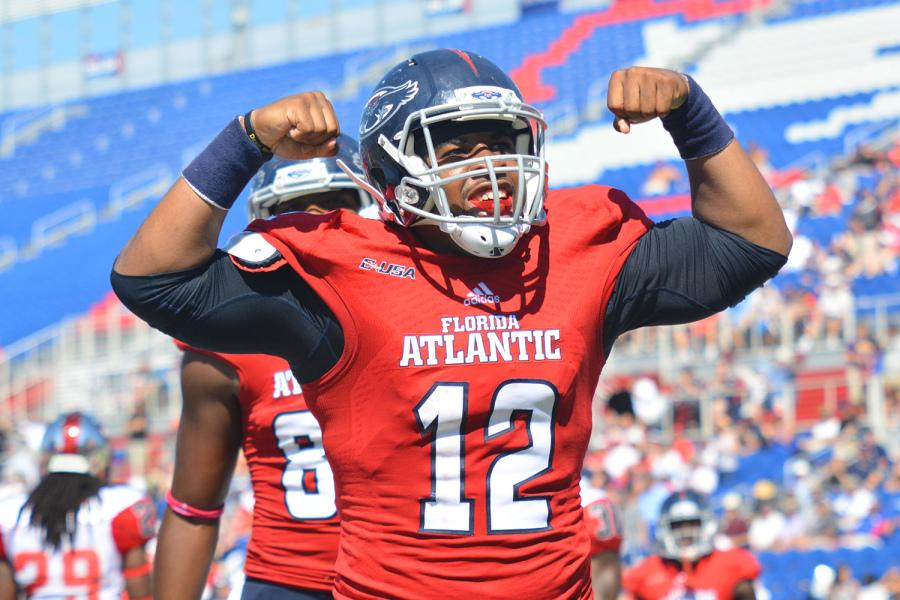 Quarterback+Jaquez+Johnson+celebrates+after+scoring+his+second+touchdown+in+FAU%E2%80%99s+45-38+win+over+WKU+last+season.+With+a+new+number+and+less+weight+on+him%2C+Quez+and+his+teammates+will+fight+for+a+conference+championship.+Photo+by+Michelle+Friswell%0A+