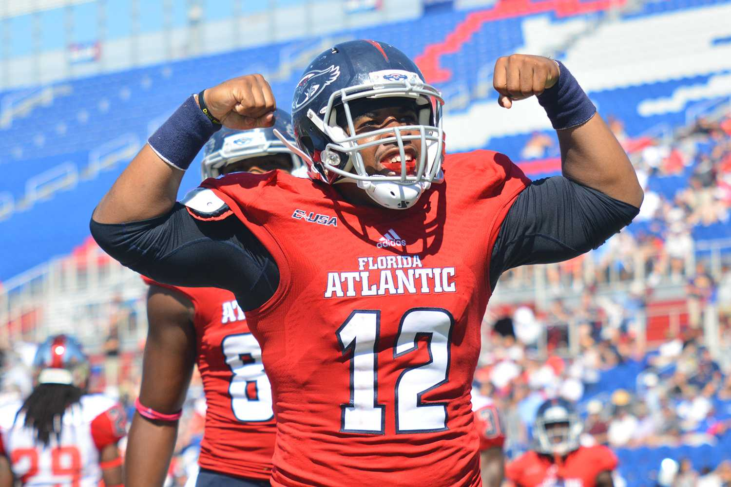 Michelle Friswell | Creative Director Quarterback Jaquez Johnson celebrates after scoring his second touchdown in FAU's 45-38 win over WKU on Saturday.