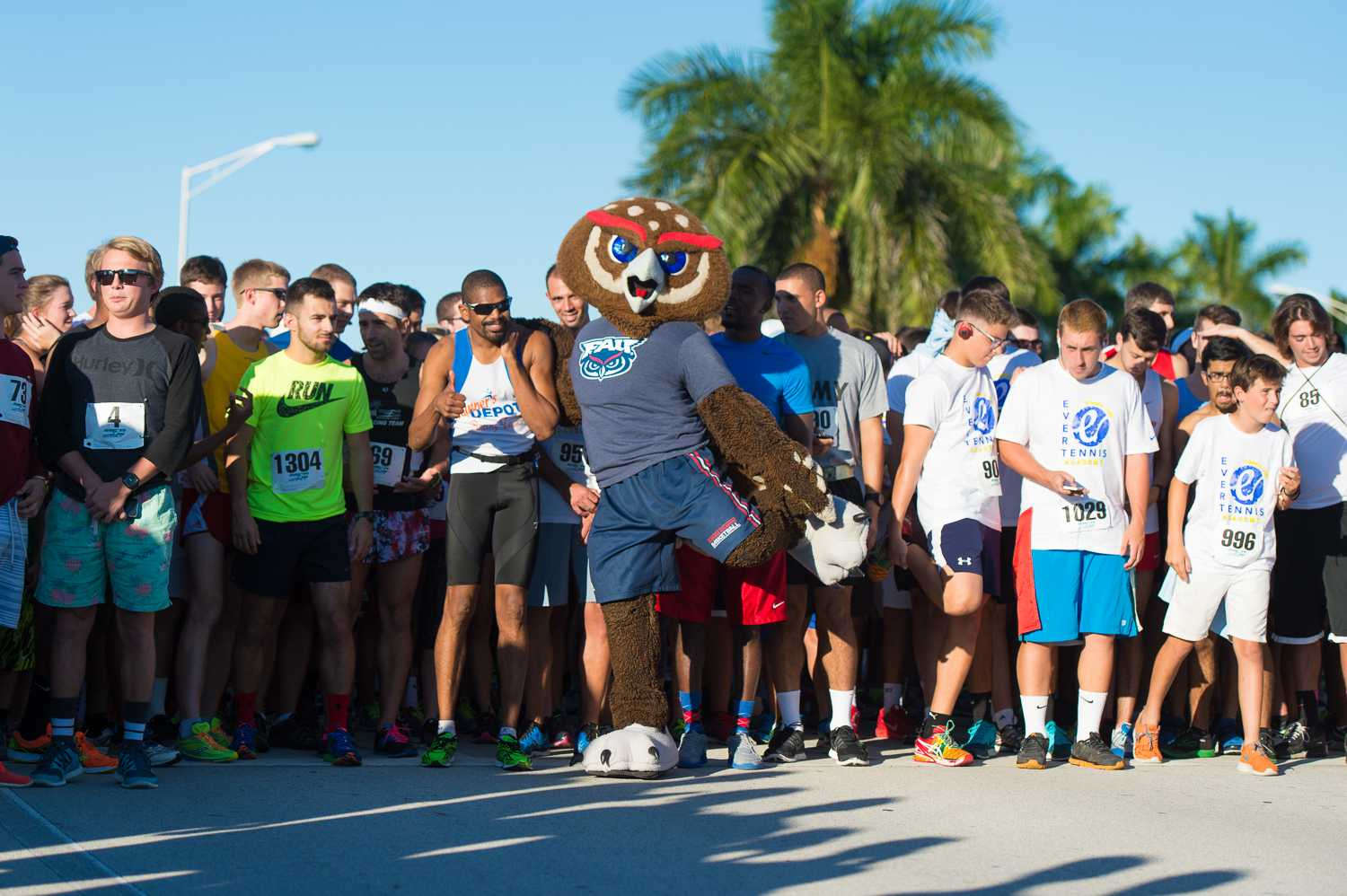 Max Jackson | Photo Editor Owsley and the rest of the runners stretching and getting ready for the 5K portion of FAU's Annual Homecoming Run for Autism to begin.