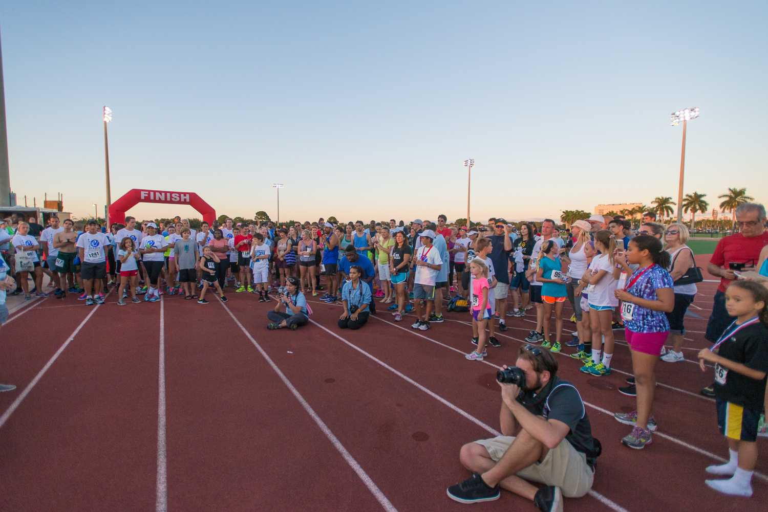 Max Jackson | Photo Editor Runners, family and friends gather at the finish line while awards are given out to the top three runners from each age category.