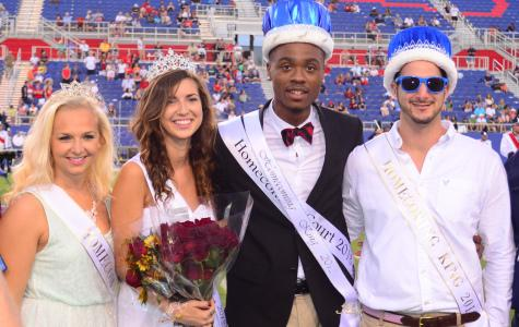 Left to right: 2012 Homecoming Queen Crystal Jozwocki, 2013 Homecoming Queen Sarah Suwak, 2013 Homecoming King Cedric Brazle and 2012 Homecoming King Dean Hasan. Max Jackson | Staff Photographer