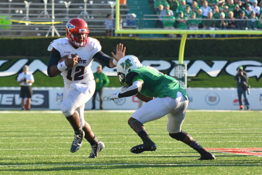 Jaquez Johnson had trouble with the Marshall defense in the second half. Photo by Michelle Friswell, Creative Director