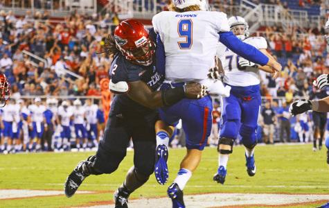 Brandin Bryant throws Tulsa quarterback Dane Evans to the ground during a game on September 13. Photo by Michelle Friswell, Creative Designer