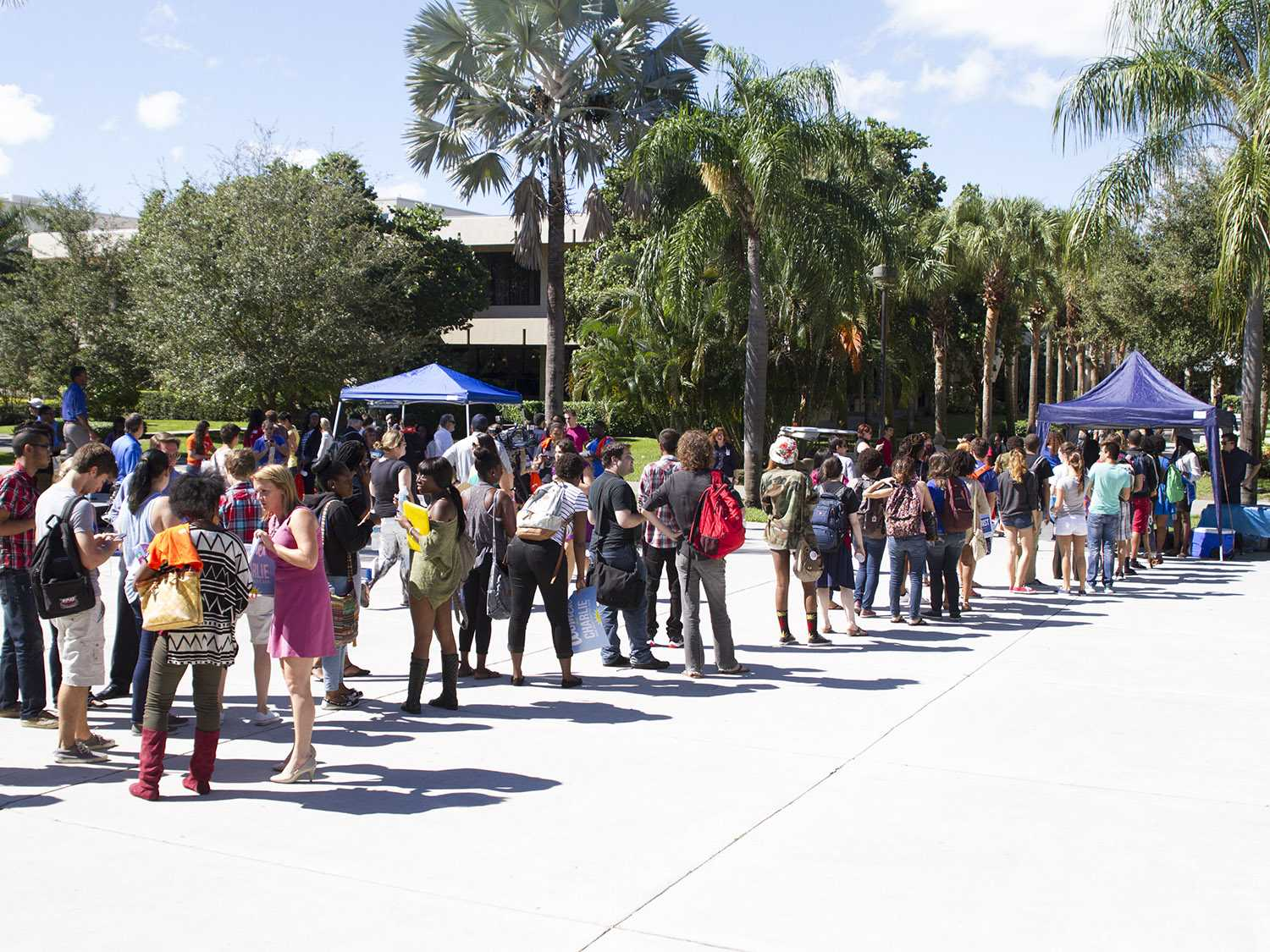 Students lined up in the free speech lawn outside of the Social Sciences building on Oct.27 for free pizza then realized gubernatorial candidate Charlie Crist was speaking only a few yards away.  [Sabrina Martinez | Assistant Creative Director]
