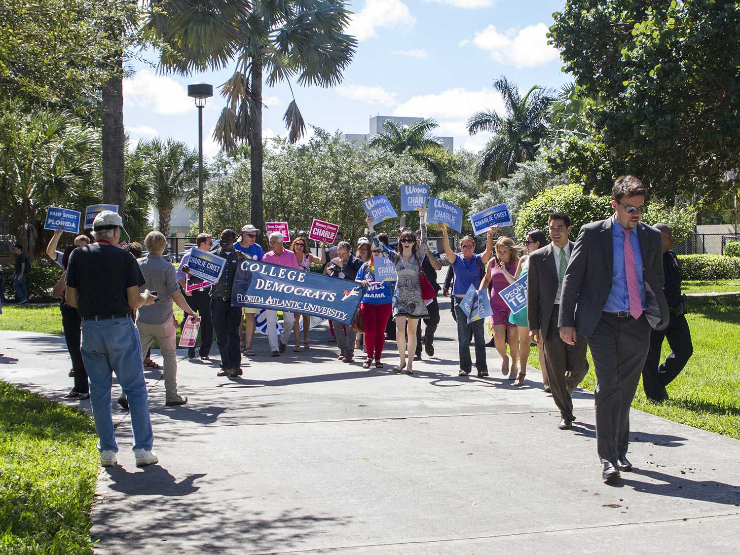 The FAU chapter of College Democrats greets Charlie Crist as he walks toward the free speech lawn. Crist is currently running as a Democrat, but has run as an Independent and Republican in past years.  [Sabrina Martinez | Assistant Creative Director]