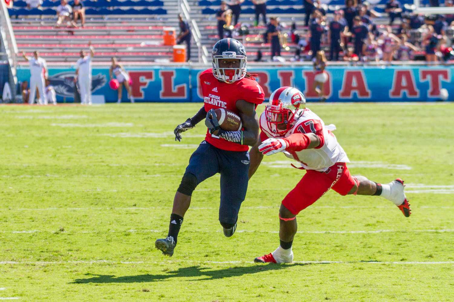 Mohammed F Emran | Web Editor  Lucky Whitehead evades a Hilltopper on his way to scoring the game-winning touchdown.