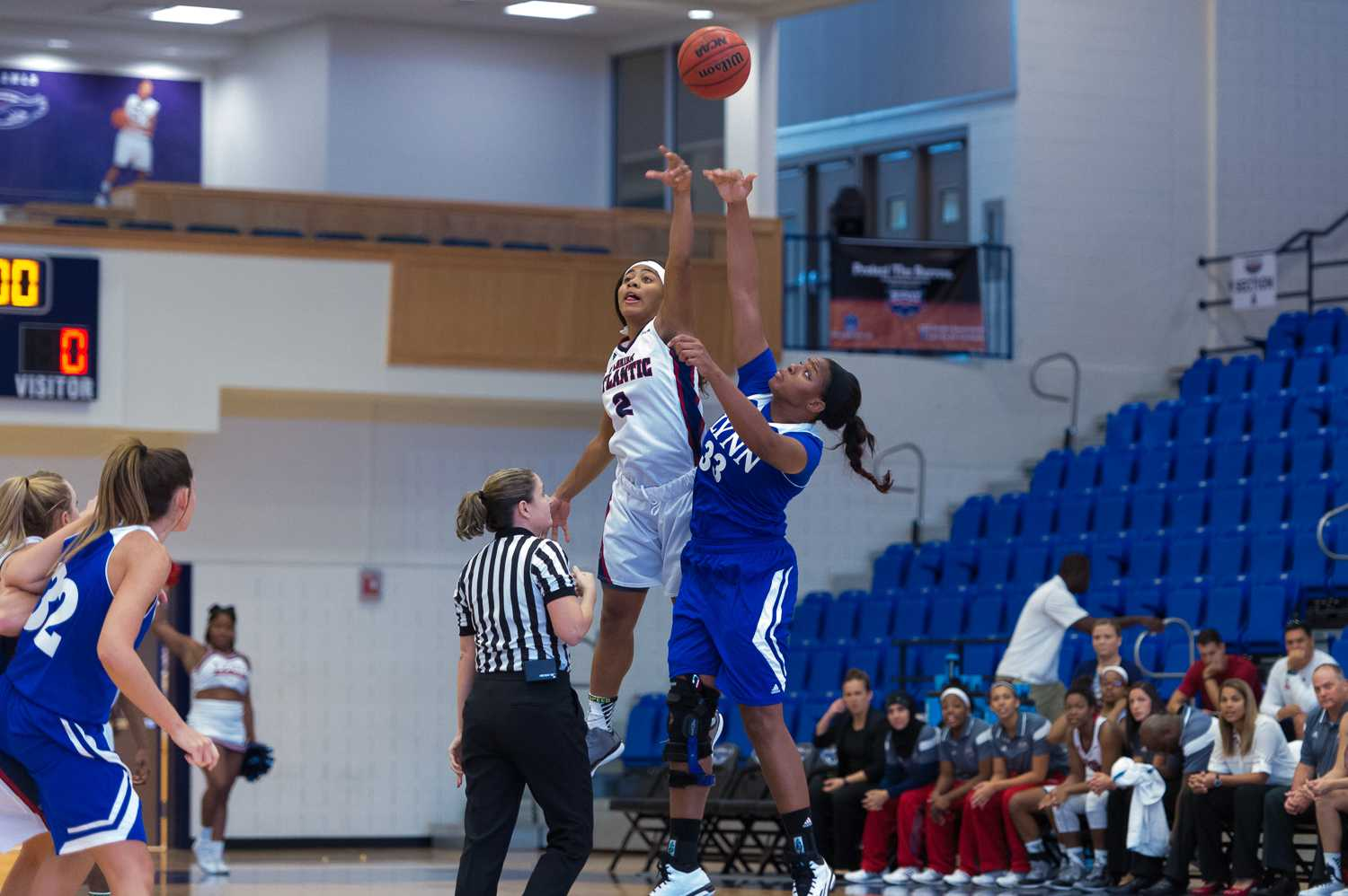 FAU's Shaneese Bailey and Lynn's Charla Nelson-James tip off to begin the exhibition game on Sunday, Nov. 9.