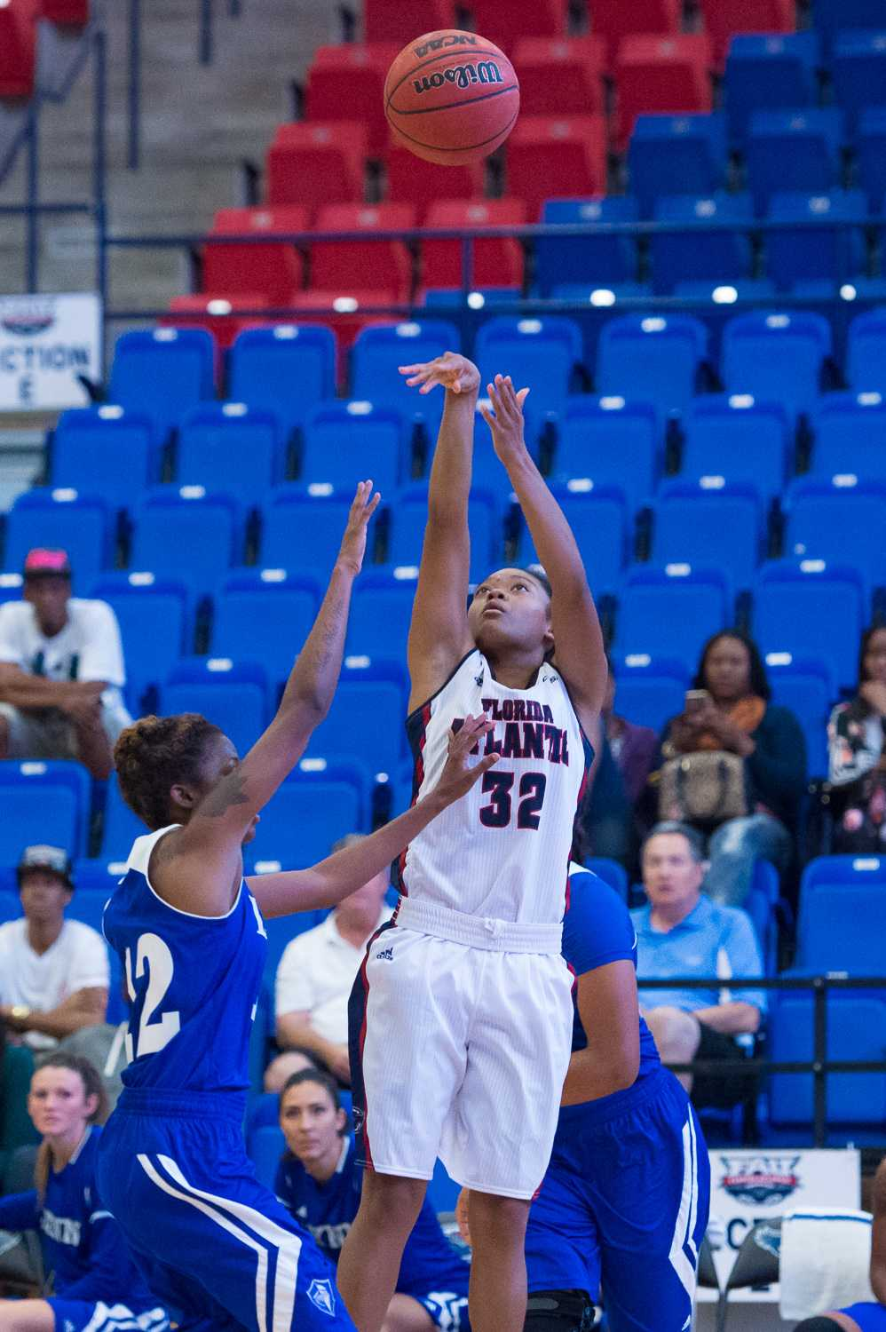 Owl guard Malia Kency takes a successful jump shot, bringing the score to 10-17 FAU early in the game.