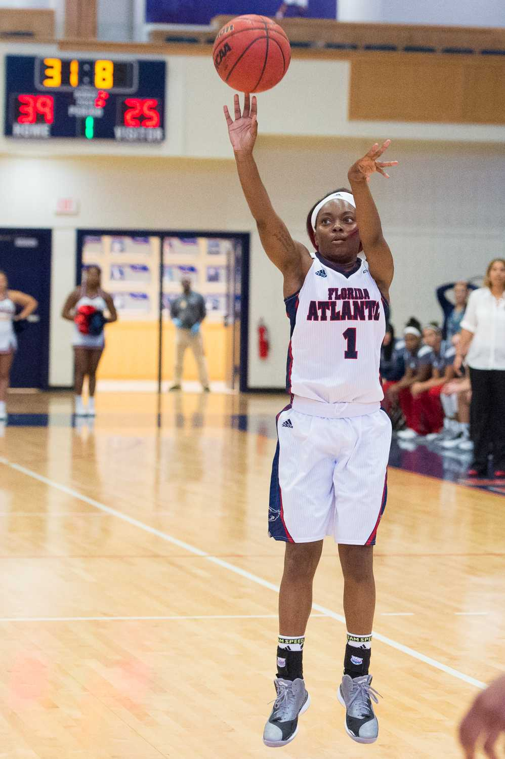 FAU guard Aaliyah Dotson converts a three pointer with less than a minute remaining in the first half.