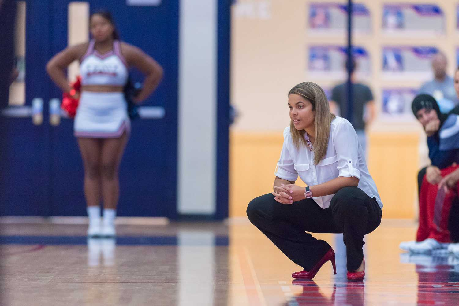 FAU Women's Basketball head coach Kellie Lewis-Jay observes her team on the court. Jay is entering her third season at the helm.