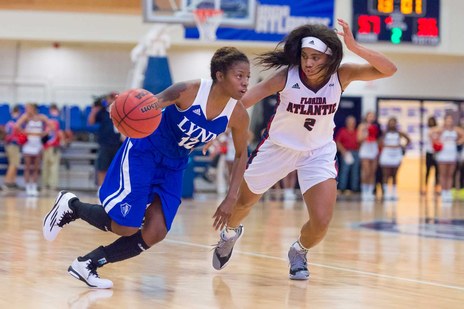 Lynn guard Sharneka McCatty moves towards the basket as Owl guard Shaneese Bailey attempts to impede her progress.