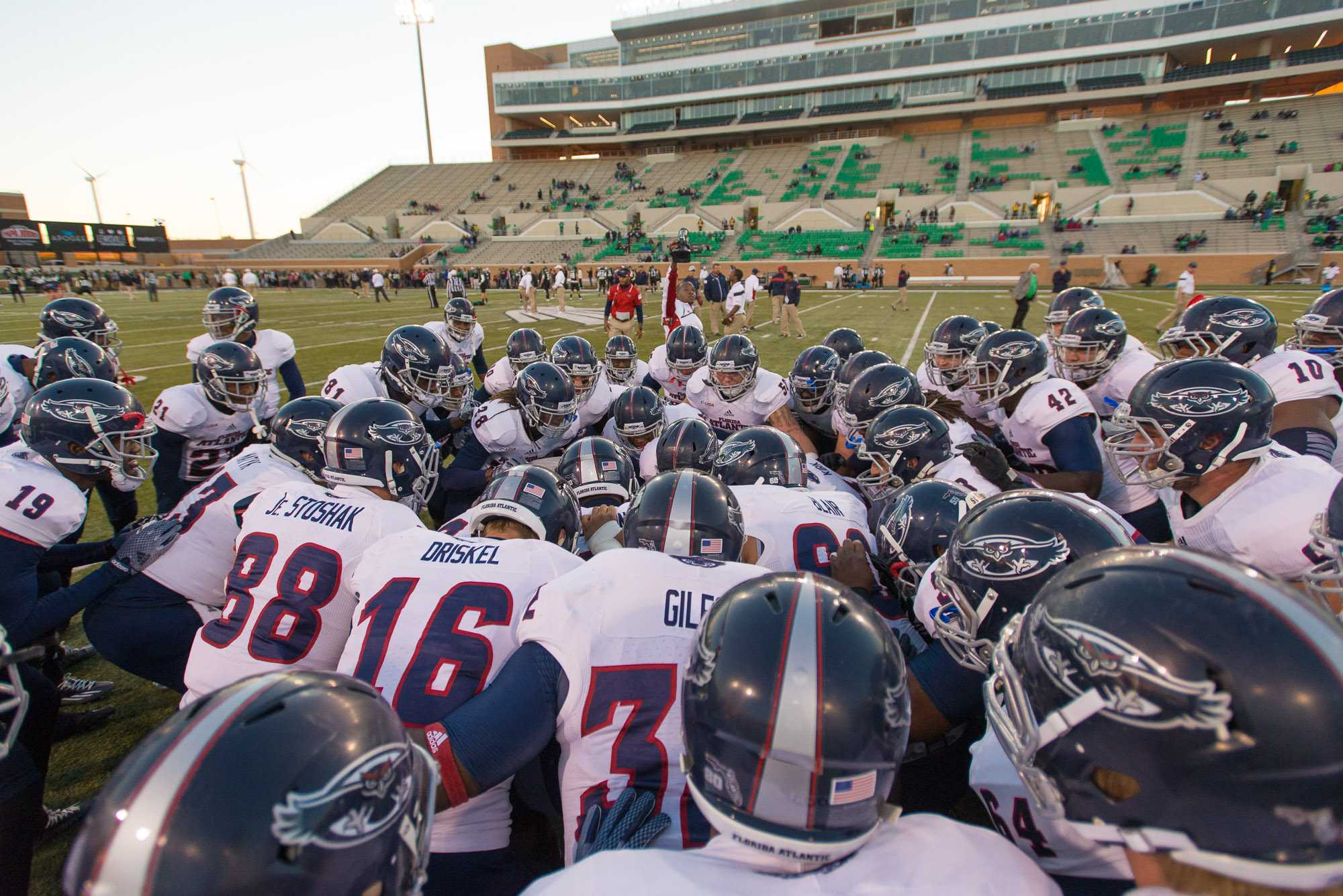 [ Max Jackson | Photo Editor ] The FAU Owls huddle up before their game against North Texas on Saturday, Nov. 8.