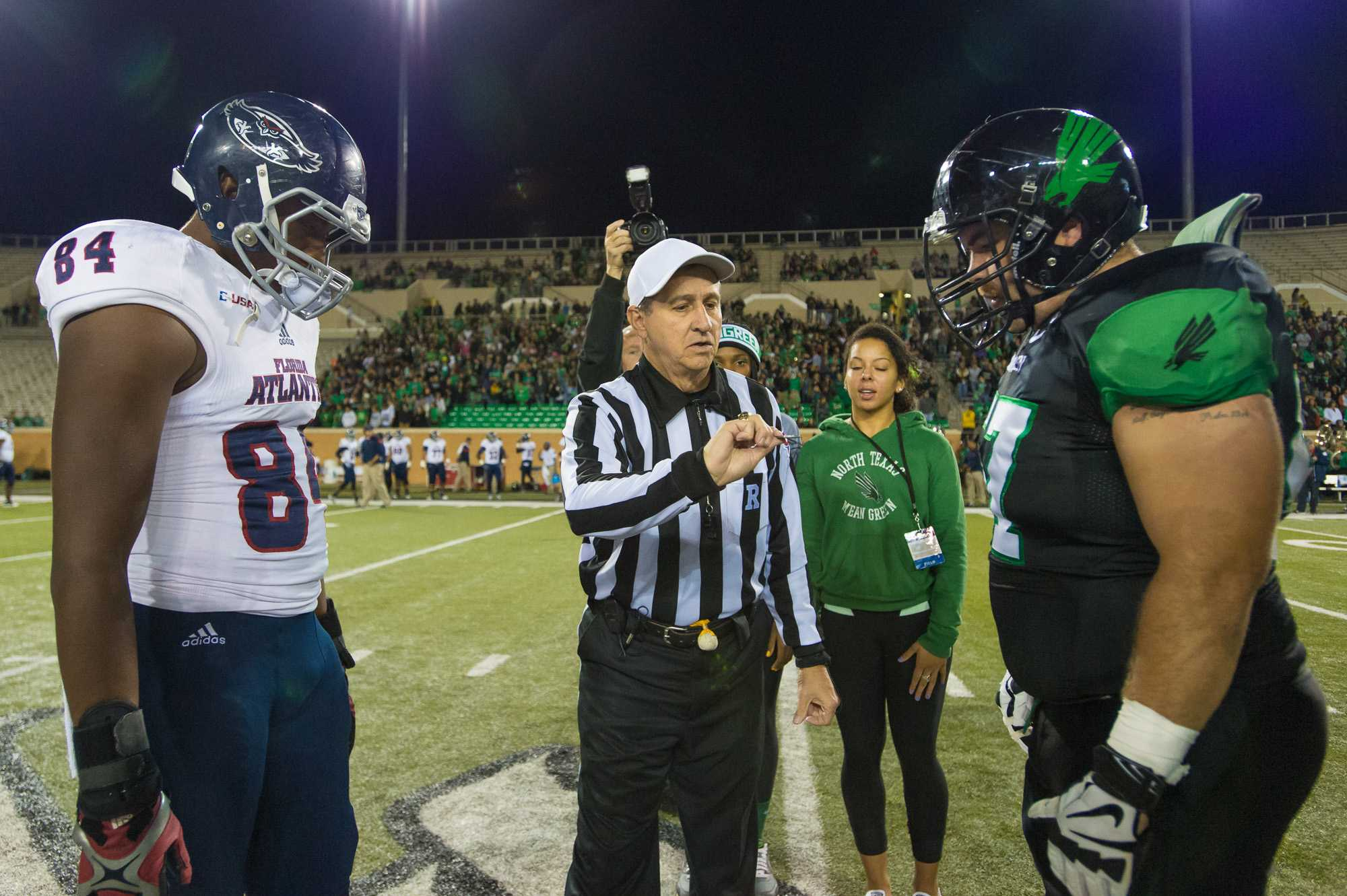 [ Max Jackson | Photo Editor ] The coin toss before FAU faced off with North Texas. Pictured is FAU captain and tight end Alex Deleon.FAU won the toss and choose to defer until the second half.