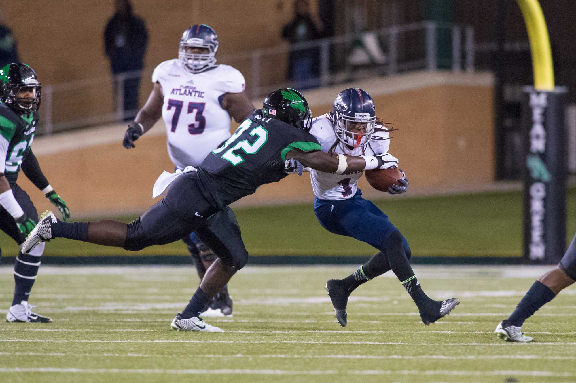 [ Max Jackson | Photo Editor ] Lucky Whitehead takes on a North Texas defender on what became a 17 yard punt return to the North Texas 47.
