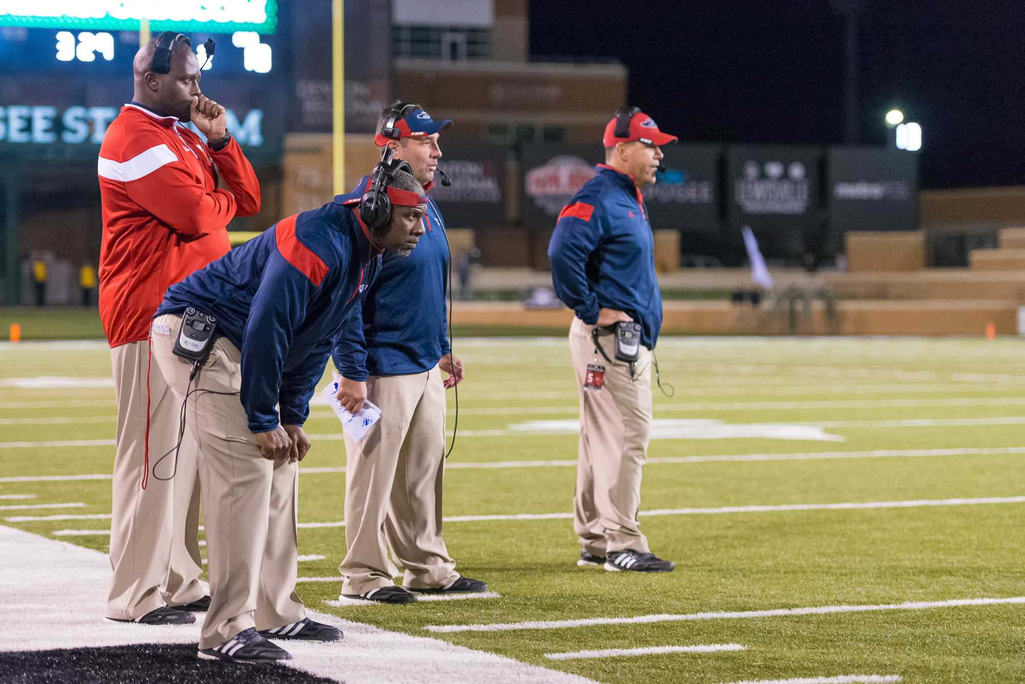 [ Max Jackson | Photo Editor ] FAU coaches stare at the end zone after North Texas scores their fourth touchdown of the game.